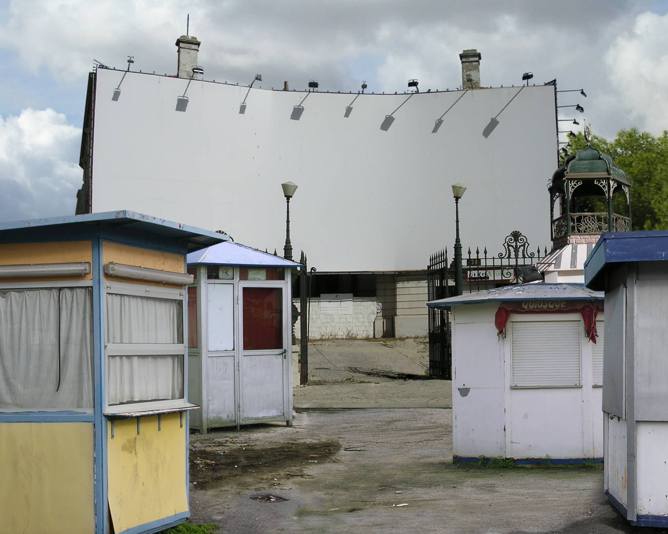 photomontage of empty billboard surface and decrepit kiosks