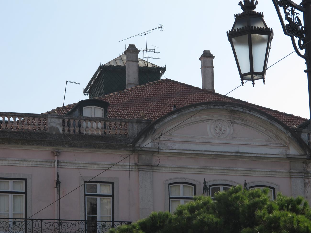 periscope visible above building facade