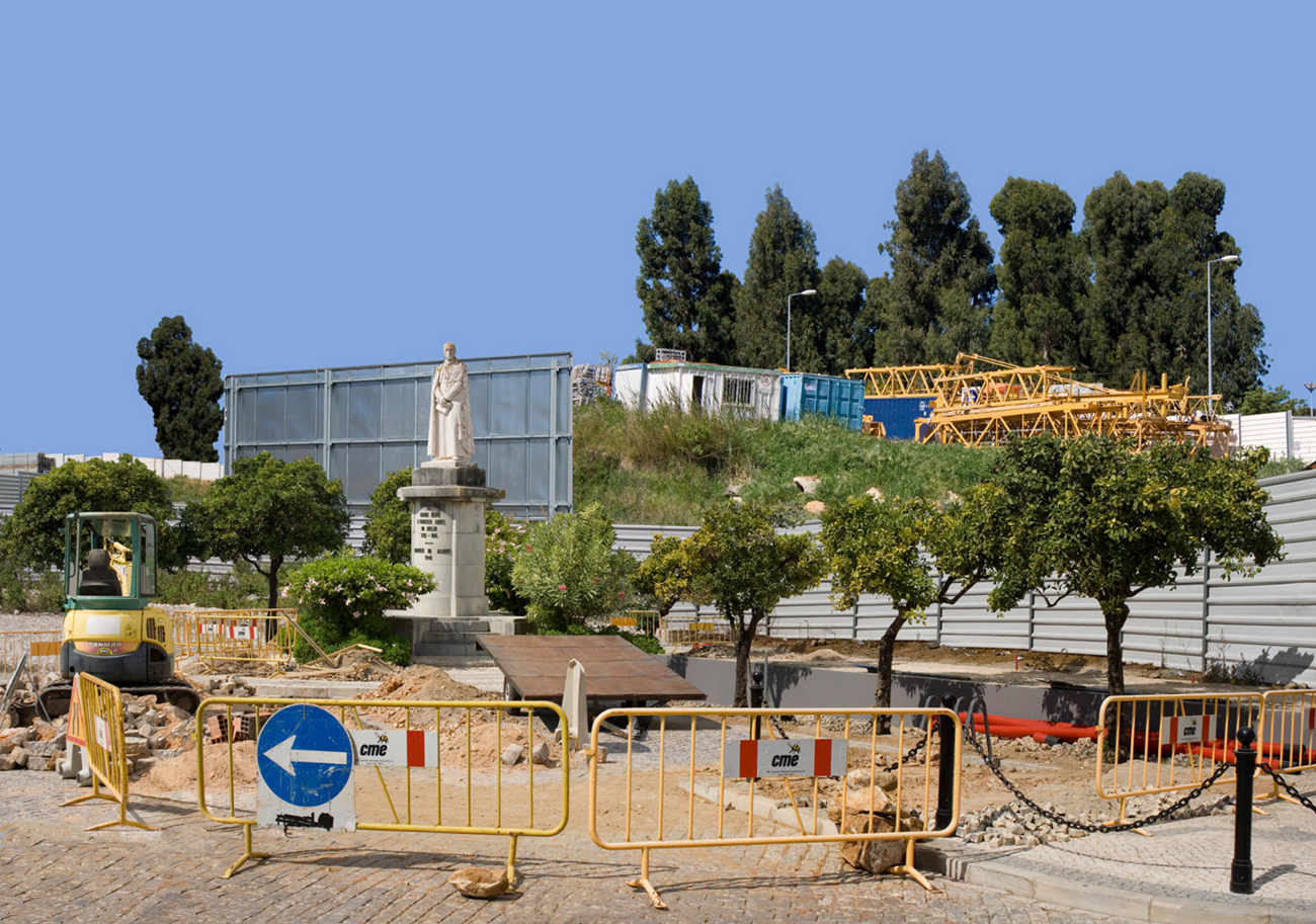landscape with statue surrounded by construction work